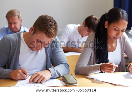 Job candicates taking tests in assessment center - stock photo