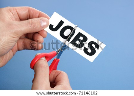 Job cutting concept for downsizing or unemployment issues - stock photo