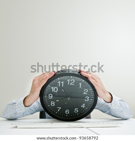 Job deadline. Businessman with clock head looking desperately down as the time passes by. Tight schedule, short terms, business stress conceptual image.