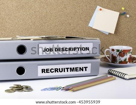 Job Description and Recruitment - two folders on white office desk - stock photo