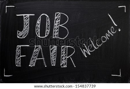 Job Fair welcome sign written on a used blackboard. Employers, recruitment agencies and job seekers use these recruitment fairs to hire people for the jobs available in their companies. - stock photo