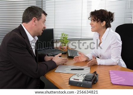 Job interview or meeting situation: business man and woman - stock photo