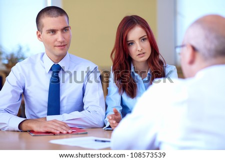 Job interview, two young colleagues from hr department and senior applicant - stock photo