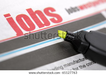 Job listing pages of a newspaper with highlighter pen - stock photo