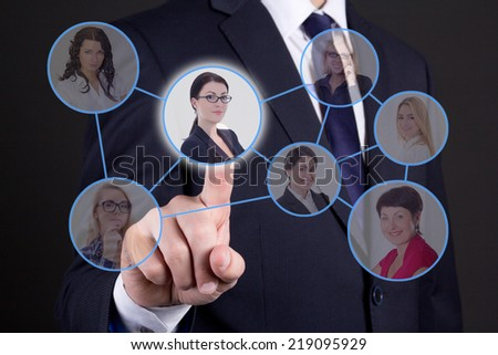 job search concept - business man pressing buttons with people portraits on touch screen - stock photo