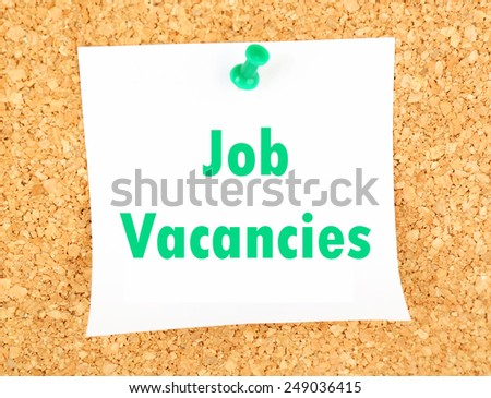 Job Vacancies text pinned up to board - stock photo