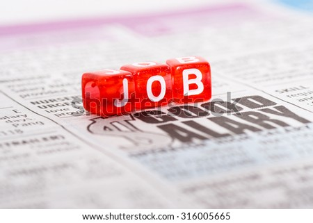 JOB wording on newspaper, looking for job concept - stock photo