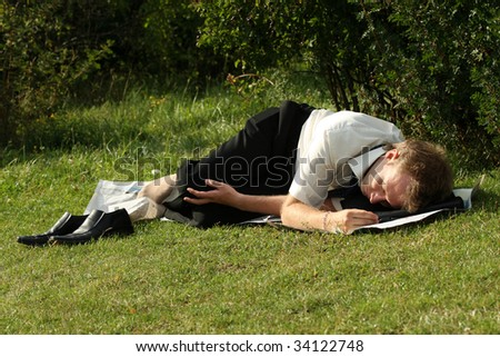 jobless businessman sleeping in a city park - stock photo