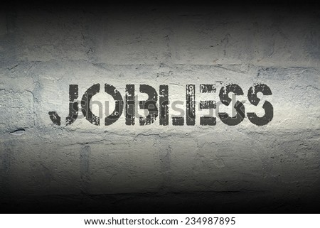jobless stencil print on the grunge white brick wall - stock photo