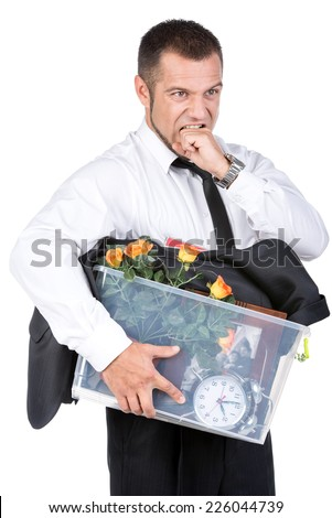 Jobless young man in suit and box with office belongings fired from job isolated on white background. looking depressed, sad an in stress. - stock photo