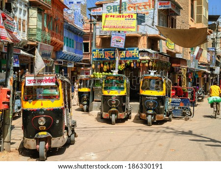 JODHPUR, INDIA - AUGUST 15: Auto rickshaws, also known as tuk-tuk, waiting for passengers on a daily market. Tuk-tuk is the most popular transport vehicle in India. Jodhpur, India, on August 15, 2012  - stock photo