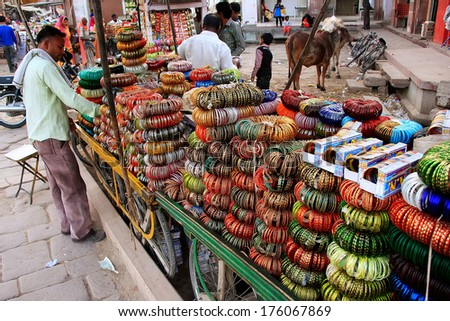 JODHPUR, INDIA - FEBRUARY 11: An unidentified man sells bangels at Sadar Market on February 11, 2011 in Jodhpur, India. Jodhpur is the second largest city in the Indian state of Rajasthan.