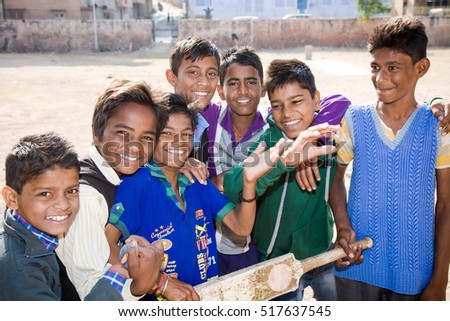 Jodhpur, India - 2015, January 4 : A cricket team of young boys posing for the camera with bat and ball