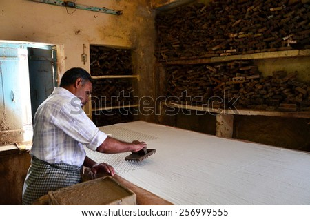 Jodhpur, India - January 2, 2015: Textile worker in a small factory on January 2, 2015 in Jodhpur, India. The textile industry continues to be the second largest employment generating sector in India. - stock photo