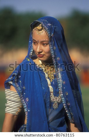 JODHPUR, INDIA - OCTOBER 6: Unidentified woman in a blue sari on October 6, 2006 at the annual Marwar Festival in Jodhpur, India. The festival includes a competition for the best dressed foreigner. This lady was a winner. - stock photo