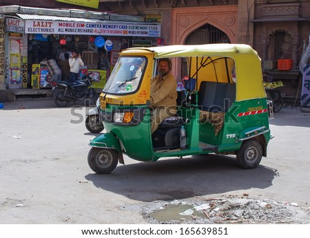 JODHPUR, INDIA - SEPT 20: Auto rickshaw taxi on Sept 20, 2013 in Jodhpur, India. These taxis are popular type of transport among locals and tourists. - stock photo