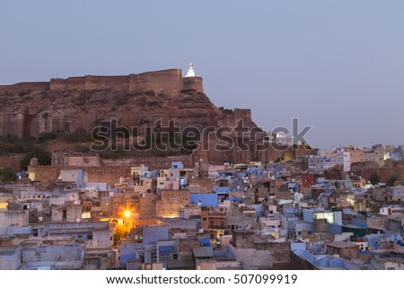 "Jodhpur is the second largest city in Rajasthan, India. It is also referred to as the ""Blue City"" due to the vivid blue-painted houses around the Mehrangarh Fort. Focus at buildings."