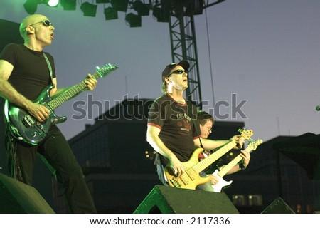 Joe Satriani and band - stock photo