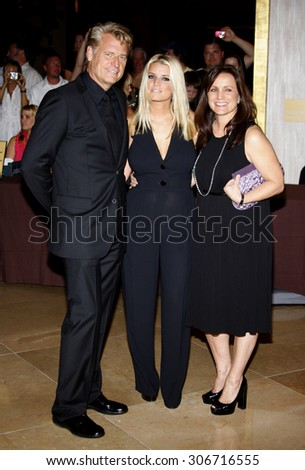 Joe Simpson, Jessica Simpson and Tina Simpson at the Operation Smile's 8th Annual Smile Gala held at the Beverly Hilton Hotel in Beverly Hills, USA on October 2, 2009. - stock photo