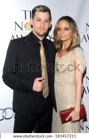 Joel Madden, Nicole Richie, in a Jasmine di Milo gown and carrying a vintage Gucci clutch, at The Noble Humanitarian Awards, Beverly Hills Hilton Hotel, Beverly Hills, October 18, 2009 - stock photo