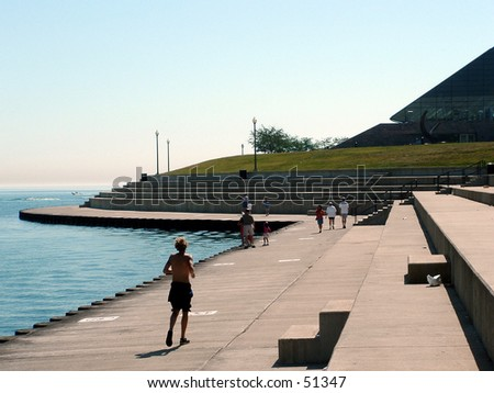 jogger along Lake Michigan shoreline - stock photo