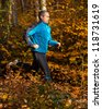 jogger in autumn - stock photo