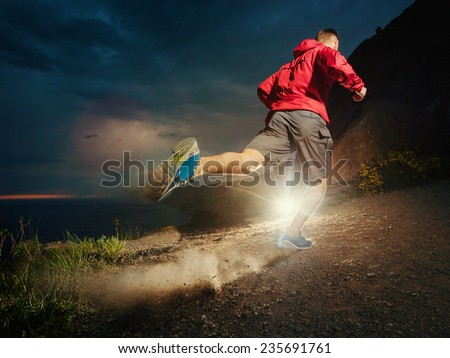 Jogger in the mountains. - stock photo