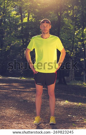 Jogger making a pause in the forest.