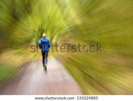 Jogger on a country trail with speed burst effect - stock photo