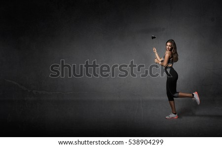 jogger taking selfie with phone, dark background
