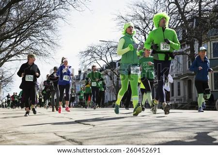 Joggers, South Boston, St. Patrick's Day Road Race, South Boston, Massachusetts, USA, 03.16.2014 - stock photo