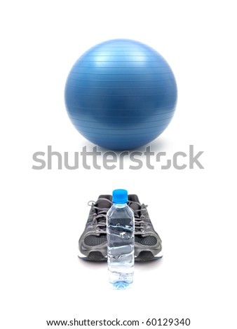 Joggers, water and a fitball isolated against a white background - stock photo