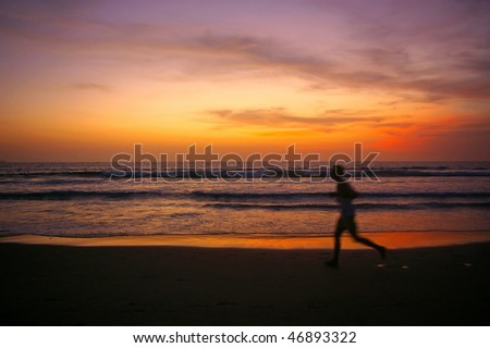 Jogging at sunset on Double Six beach, Seminyak, Bali, Indonesia.