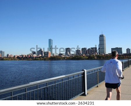 Jogging by Charles River Boston Massachusetts - stock photo