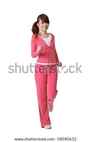 Jogging girl with joy, full length portrait isolated on white background. - stock photo