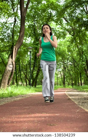 Jogging in the park - stock photo