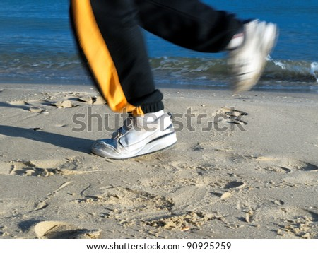 jogging on the beach, closeup of feet