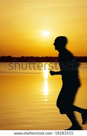 Jogging on the beach with fantastic sunset