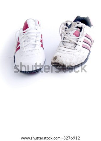 jogging shoes, new and used on white background - stock photo