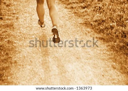 jogging through the landscape - stock photo
