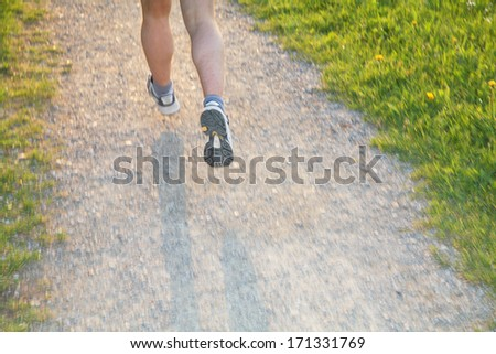 jogging through the landscape..MOTION-EFFECT to visualize speed!!!............ - stock photo