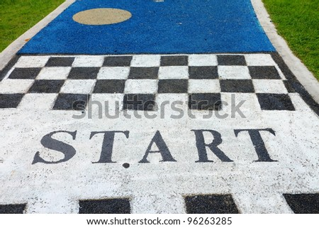 jogging track in the park with start sign - stock photo