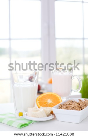 Joghurt, fruits, milk and cereal / Healthy and delicious breakfast - stock photo