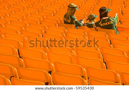 JOHANNESBURG - AUGUST 21: South African Rugby supporters wait for start of play against  the New Zealand All Blacks at the FNB stadium on August 21, 2010 in Johannesburg. - stock photo