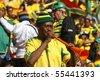 JOHANNESBURG - JUNE 11: A South African supporter blows a vuvuzela at a World Cup match between South Africa and Mexico June 11, 2010 in Johannesburg, South Africa. - stock photo