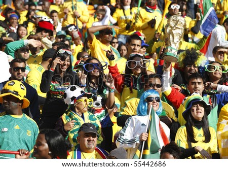 JOHANNESBURG - JUNE 11:  Crowd at a World Cup match between South Africa and Mexico June 11, 2010 in Johannesburg, South Africa. - stock photo