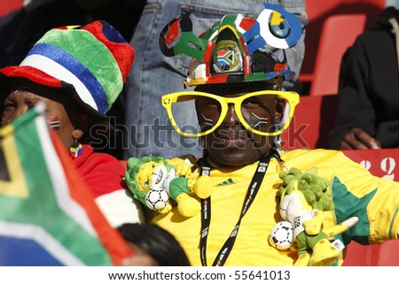 JOHANNESBURG - JUNE 18:  Spectator at a 2010 FIFA World Cup soccer match between Slovenia and the USA June 18, 2010 in Johannesburg, South Africa. - stock photo