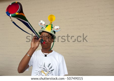 JOHANNESBURG - MARCH 28: Vuvuzuela is the trumpet of south african soccer fans, here a fan singing it 28 march 2010 Joahnnesburg,South Africa - stock photo