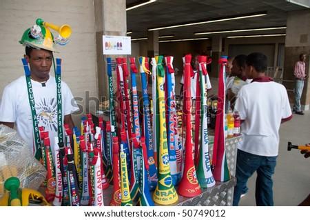 JOHANNESBURG - 28 MARCH:  vuvuzuela trumpet with national team flag displayed in the stadium of johannesburg - stock photo