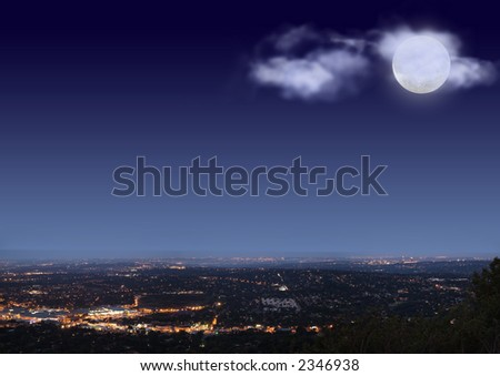 Johannesburg night cityscape with big bright moon and clouds on blue black sky - stock photo